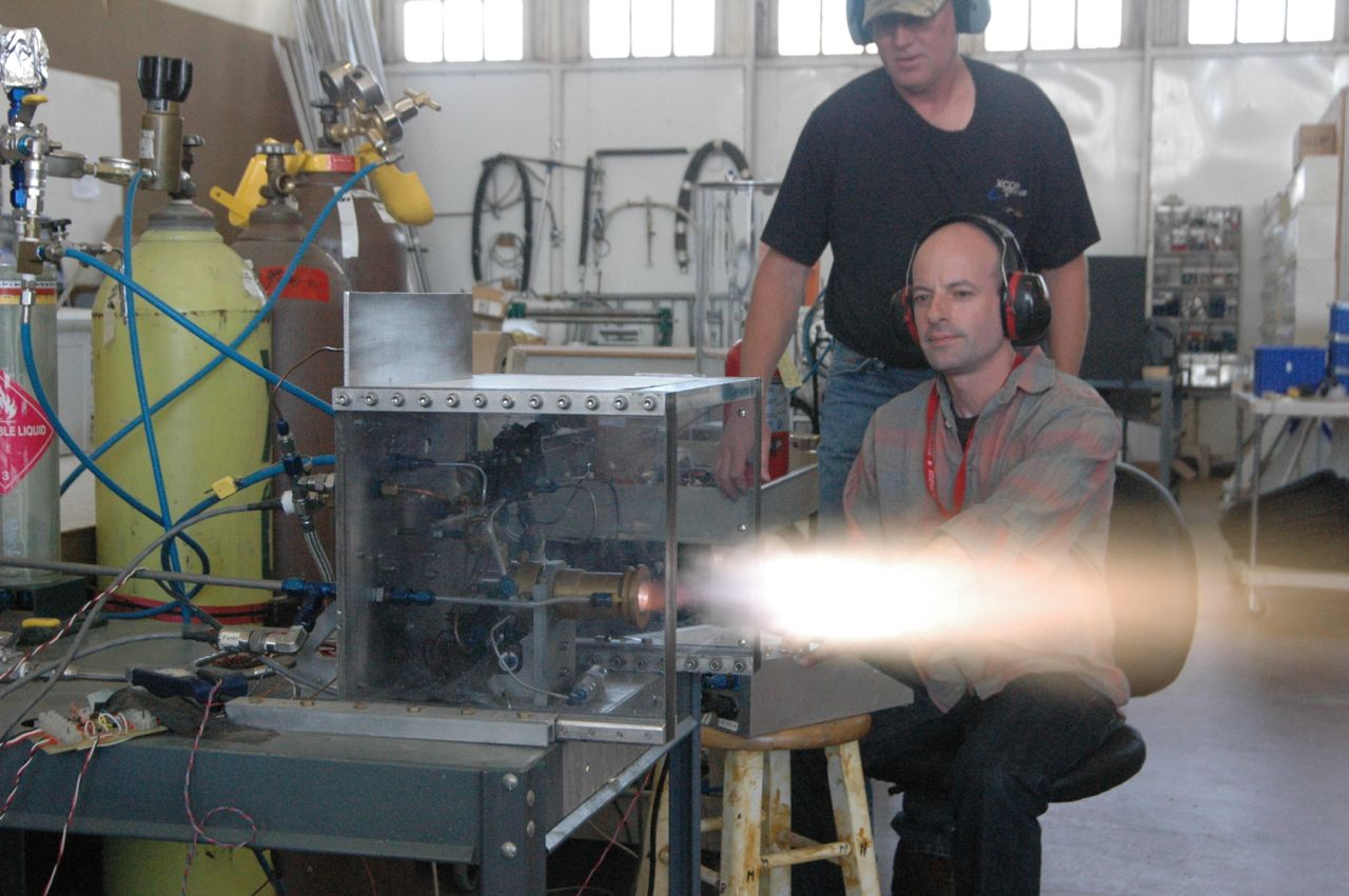 Michael Belfiore pushing the button on a static fire test of an XCOR rocket engine.